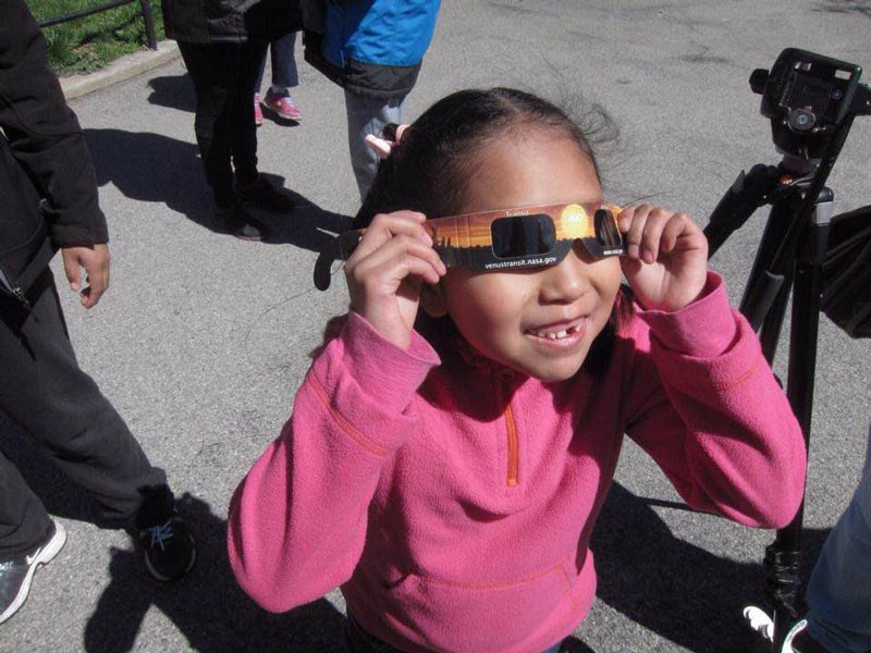 young astronomer with eclipse glasses